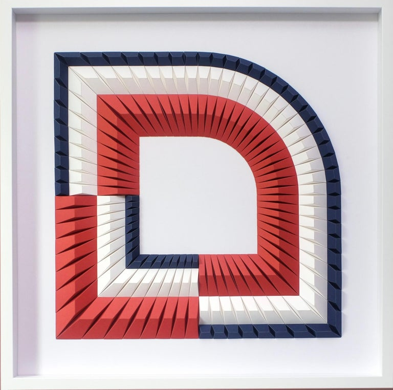 """This beautiful geometric abstract wall sculpture is made out of colored laser cut paper that was hand folded by Yossi Ben Abu. It comes in white wooden frame and a non glare museum glass. """"As an artist, I enjoy studying patterns, shapes, placement"""