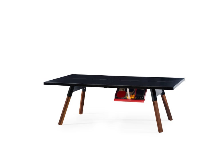 It's a ping-pong table. Medium sized for enthusiasts with less space, with a surface, a design, and a structure that gives it full playability. But, it's also a large dining table or whatever you want. All the sportiness that it gets from the net,