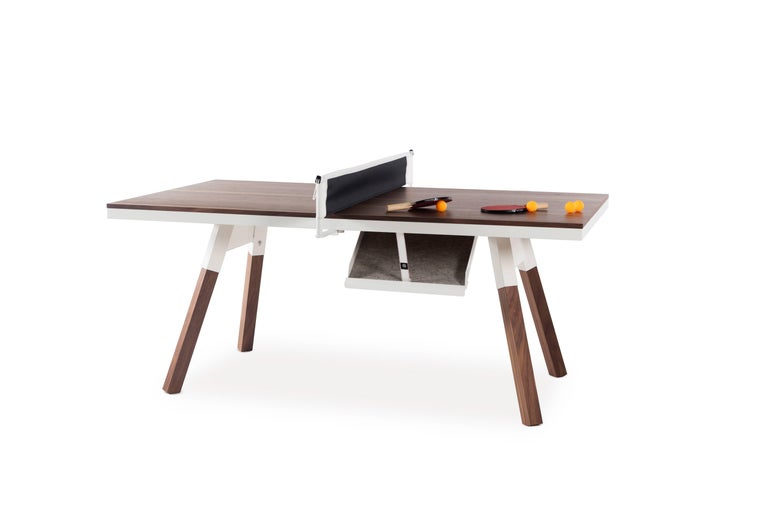 It's a piece of fine furniture and a ping-pong table. Small sized for those with less space, with a wood veneer surface and solid wood legs, a design, and a structure that gives it full playability. When not being used for play, it's also a desk,