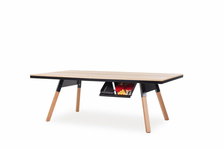 It's a piece of fine furniture and a ping-pong table. Medium sized for those with less space, with a wood veneer surface and solid wood legs, a design, and a structure that gives it full playability. When not being used for play, it's also a dining