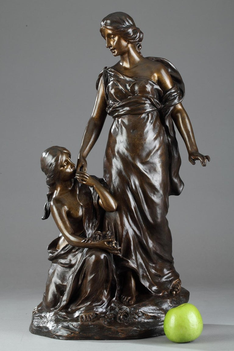 Late 19th century bronze group featuring two young women with flowers on a small naturalistic terrace. Signed on the terrace: KINSBURGER. Sculptor and engraver in medals, Sylvain Kinsburger (1855-1935) presented to the Paris Salon from 1878 onward,