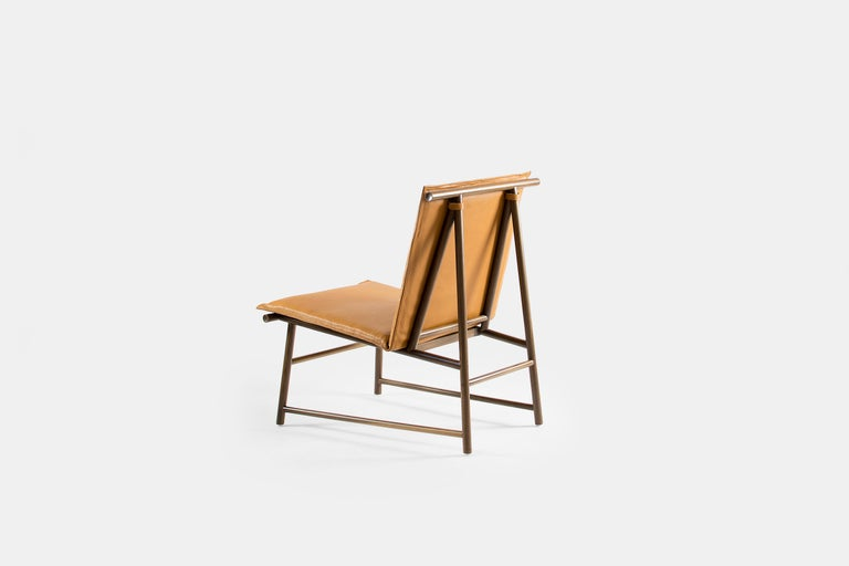 """The """"Your Skin"""" easy chair is a comfortable low chair with a solid and light structure perfect to accentuate with its impeccable and minimal aesthetics the decoration in every room or create an informal meeting point around a low table. Their seat,"""