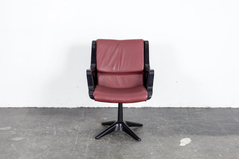 Yrjo Kukkapuro swivel side or desk chair in black molded plastic with newly upholstered wine colored leather cushion. Made in Finland by Haimi.