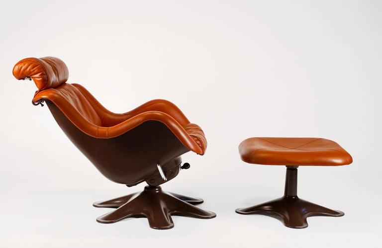 $16,500 for a set of three Karuselli lounge chairs by Yrjo Kukkapuro for Haimi of Finland in terracotta leather with chocolate brown frames. The set includes three model 418 easy chairs. We have one removable headrest available for $1,000. Sold as a
