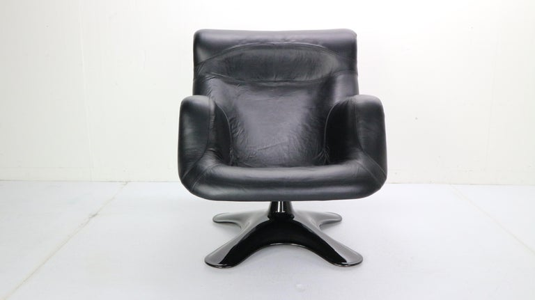 This exclusive lounge chair- 'Karuselli' is designed by Yrjo Kukkapuro for Haimi manufactured in 1960s, Finland.  Organic shaped lounge chair is made of black leather newly upholstered and has a black fiberglass seat shell& base. The base is