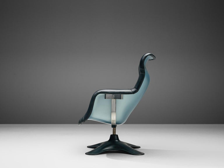 Yrjö Kukkapuro for Haimi, 'Karuselli' lounge chair, black leather, metallic blue and black fiberglass, Finland, 1960s.  Organic shaped lounge chair by Finnish designer Yrjö Kukkapuro. This chair consist of a moulded plastic shell with thick