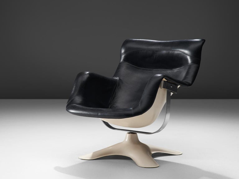 Yrjo Kukkapuro for Haimi, 'Karuselli' lounge chair, black leather, white fiberglass, Finland, 1960s.  Organic shaped lounge chair by Finnish designer Yrjo Kukkapuro. This chair consist of a moulded plastic shell with thick leather cushions on the