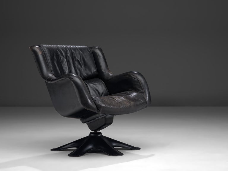 Yrjo Kukkapuro for Haimi, 'Karuselli' lounge chair, leather, fiberglass and plastic, Finland, 1960s.  Organic shaped lounge chair by Finnish designer Yrjo Kukkapuro. This chair consist of a molded plastic shell with thick leather cushions on the