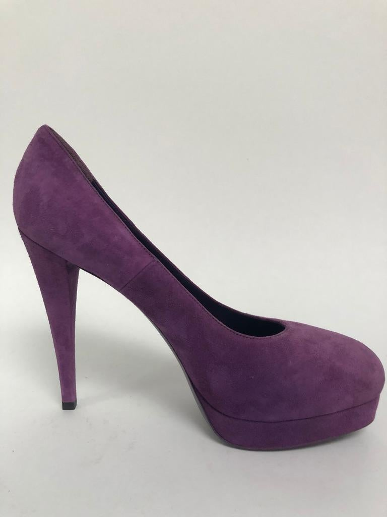 Beautiful soft purple suede pump with concealed platform.