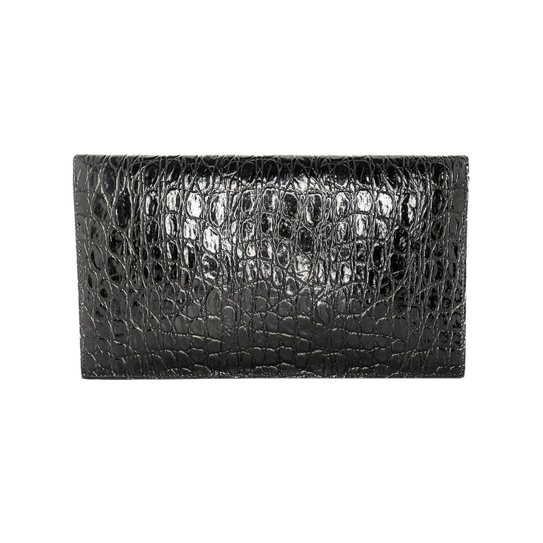 Saint Laurent's 'Uptown' pouch fits everything you need for an evening at a gallery opening or rooftop bar. It's been made in Italy from glossy croc-effect (Calf) leather and decorated with the iconic 'YSL' hardware in gold. Carry it in hand or slip