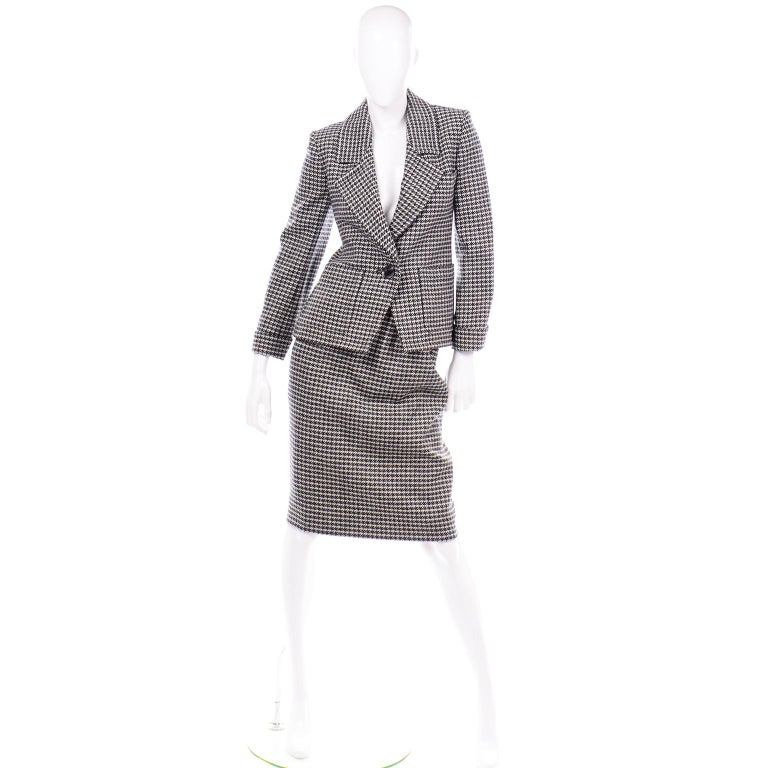 This vintage YSL two piece houndstooth wool skirt suit is in as new condition. This Yves Saint Laurent Rive Gauche early 1980's pencil skirt and single breasted blazer  jacket was most likely never worn! The suit is fully lined and has beautiful