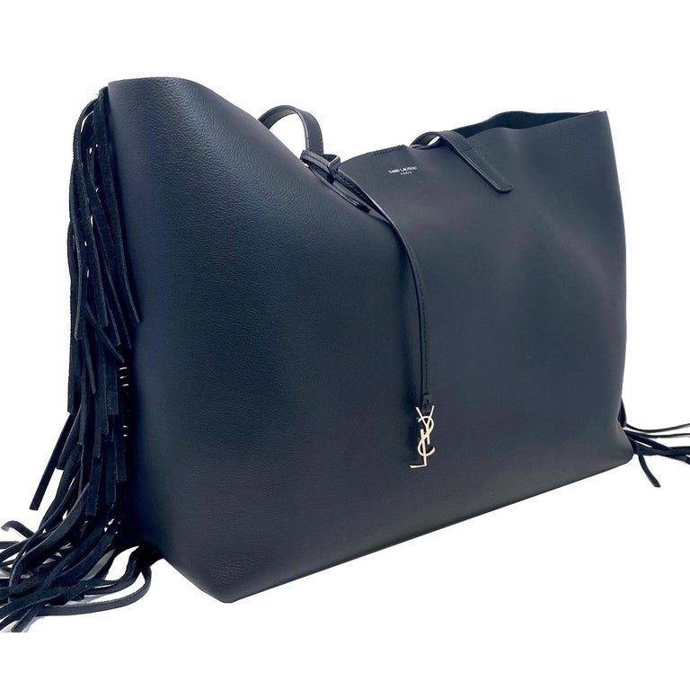 Company-YSL Yves Saint Laurent Style-Black Fringe Leather Tote Outside- No Rips , Tear or Marks Inside-Bag interior has white marks and stain - CHECK PICTURES Pockets -NO Pockets Handles/ Straps- 10