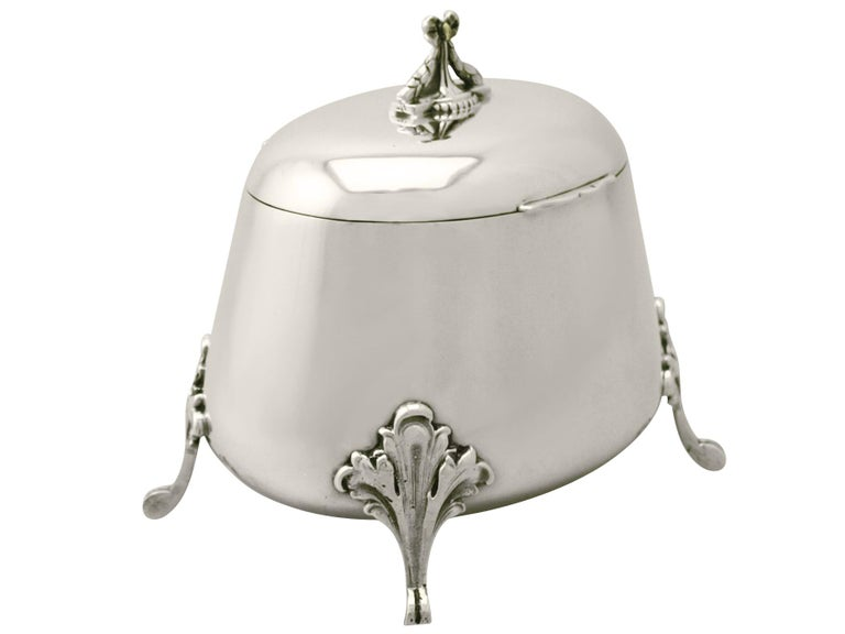 A fine and impressive antique Yugoslavian silver tea caddy; an addition to our silver teaware collection.  This fine antique Yugoslavian silver tea caddy has an oval rounded, tapering form.  The surface of the box is plain and