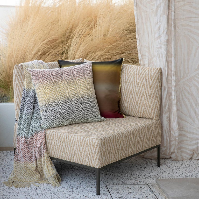 From the Missoni Home Terre Collection, this throw blanket features the house's unmistakable zigzag pattern in a warm, natural colorway. Completing the throw's cozy effect is a soft fringe. Inspired by earth tones, the Terre Collection features a