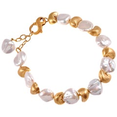 Yvel 18 Karat Gold and Pearl Bracelet