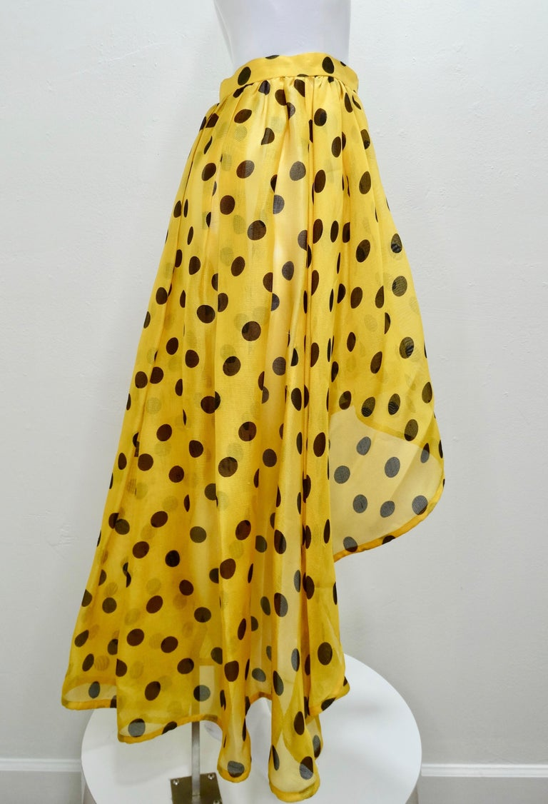 Add some color to your look with this adorable YSL skirt! Circa 1980s, this flamenco wrap skirt is crafted from 100% mesh Silk and features a contrasting yellow and black polka dot pattern and an asymmetrical hem. Colorful and chic, this skirt will