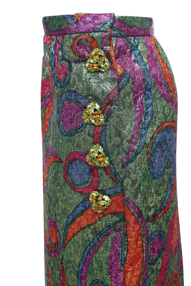 This incredible metallic print skirt by Yves Saint Laurent is from the 1989 Rive Gauche collection and remarkably has the original boutique tags still in tact. The thick metallise wool fabric is a spectacular array of colour in emerald green, lilac,