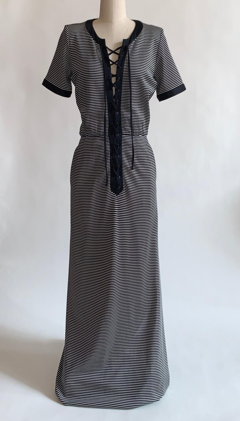 1990s vintage Yves Saint Laurent Rive Guache maxi dress in a dark navy (almost black) and white stripe pattern with solid trim at neck and sleeves. Adjustable lace up front. Side pockets and slit at one side. Side zip.    71% acetate, 23% polyamide,