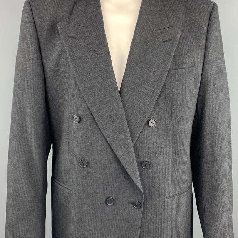 VINTAGE YVES SAINT LAURENT sport coat comes in a dark gray textured wool featuring a double breasted style, peak lapel, and slit pockets.   Very Good Pre-Owned Condition. Marked: (No size)   Measurements:   Shoulder: 20 in. Chest: 44 in. Sleeve: