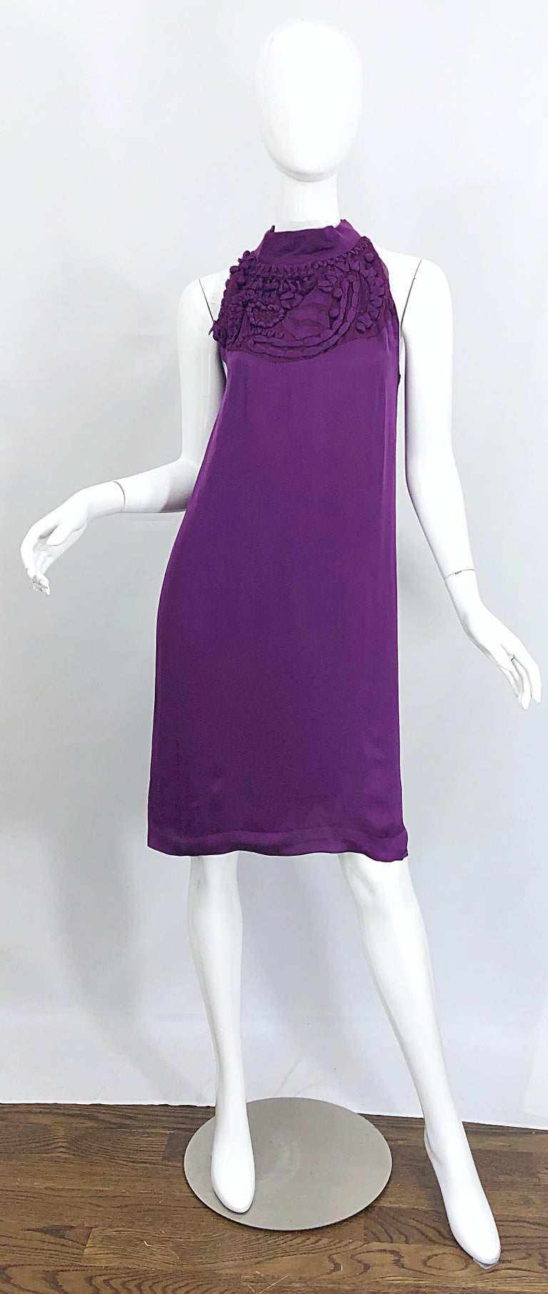Chic YVES SAINT LAURENT Autumn / Winter 2007 purple silk dress! Features intricate details above bust. Single button closure at back neck. Fully lined. Can easily be worn day to evening. Perfect with sandals, wedges or flats for day, and heels or