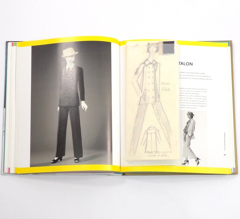 Yves Saint Lauren  - All About Yves. Larousse, Paris 2016. First edition.  Lushly produced with Illustrations from the start of his career onwards with expensively produced facsimile inserts of Doll cut-outs, sketches, letters, polaroid photographs,