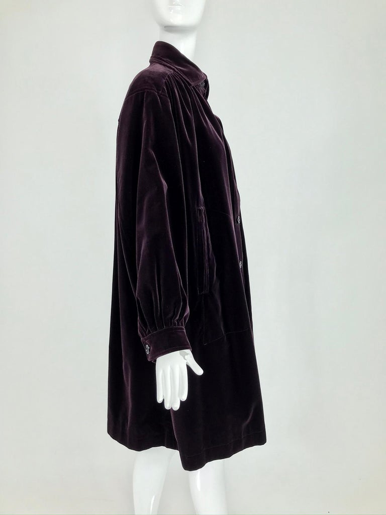 Yves Saint Laurent aubergine velvet smock coat from the 1970s. I love this coat, we've sold another in black a couple of years ago, but this colour is most amazing. Aubergine in cotton velvet, the colour changes depending on the light. The coat is a