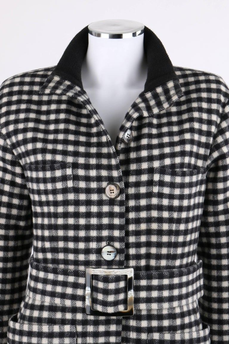 Yves Saint Laurent Autumn / Winter 1992 YSL black and white wool cashmere shepherd check belted coat. Black rib knit standing collar. Seven center front button closures. Long sleeves with black rib knit cuffs. Two single welt breast pockets. Two