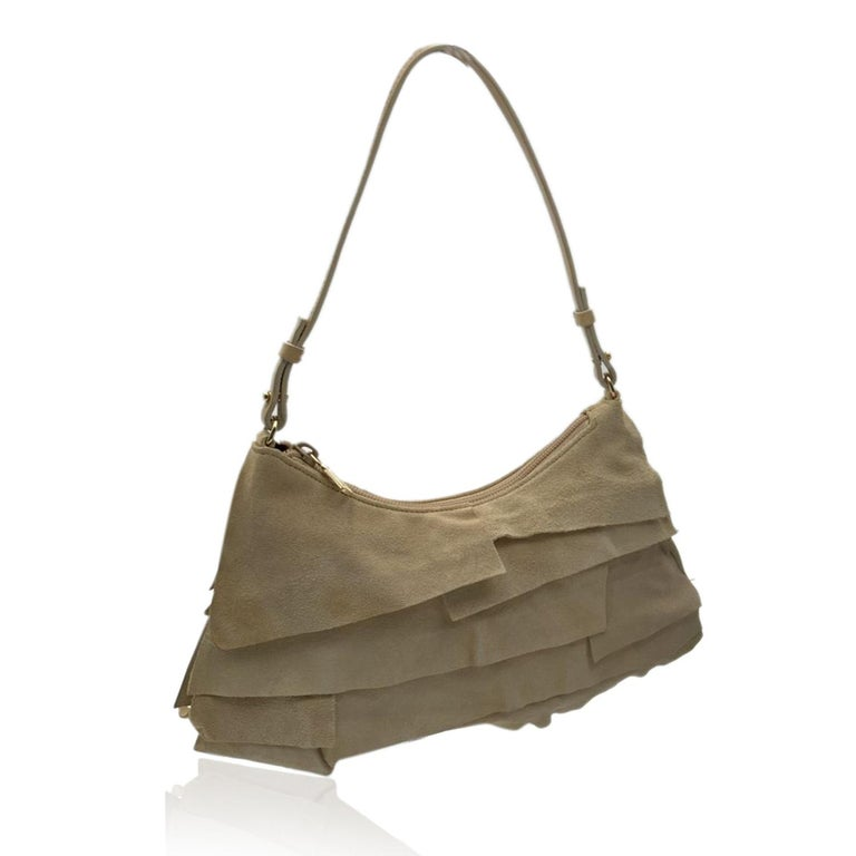 Beautiful YVES SAINT LAURENT small 'ST TROPEZ' ruffle bag in ivory color. Soft layer of ruffled suede cover the exterior. Gold hardware, upper zipper closure, chocolate fabric lining.'YVES SAINT LAURENT Rive Gauche' tag inside (with serial number on