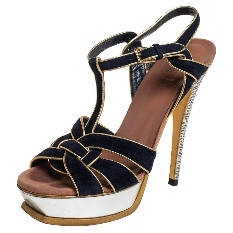 One of the most sought-after designs from Yves Saint Laurent is their Tribute sandals. They are such a craze amongst fashionistas around the world, and it is time you own one yourself. The sandals are crafted from suede in a black shade and trimmed