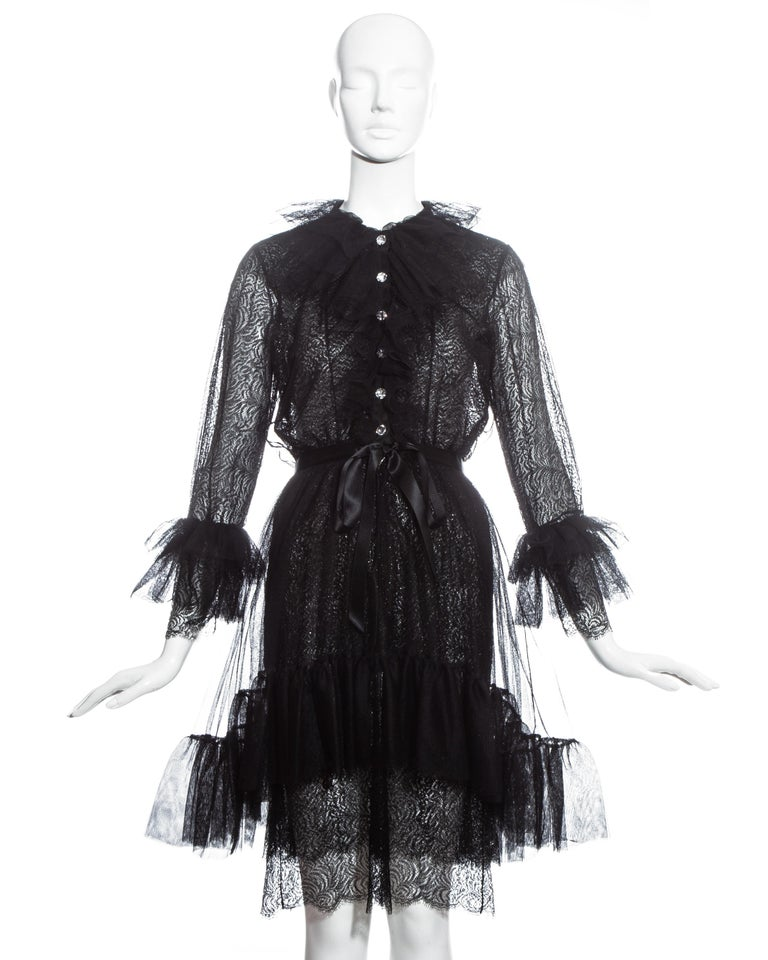 Yves Saint Laurent black lace and tulle cocktail dress with crystal buttons, detachable silk slip dress, silk bow belt and ruffled collar, skirt and cuffs.  Fall-Winter 1993