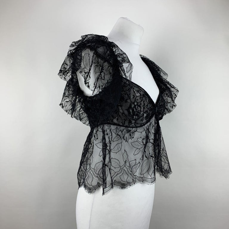 Yves Saint Laurent Black Lace Sheer Top. Frills detailing . Cropped length. Fabric / Material: 1st fabric:60% Viscose - 40% Nylon / 2nd fabric:80% Nylon - 20% Elastan. Color / Effect:Black Size: M (The size shown for this item is the size indicated
