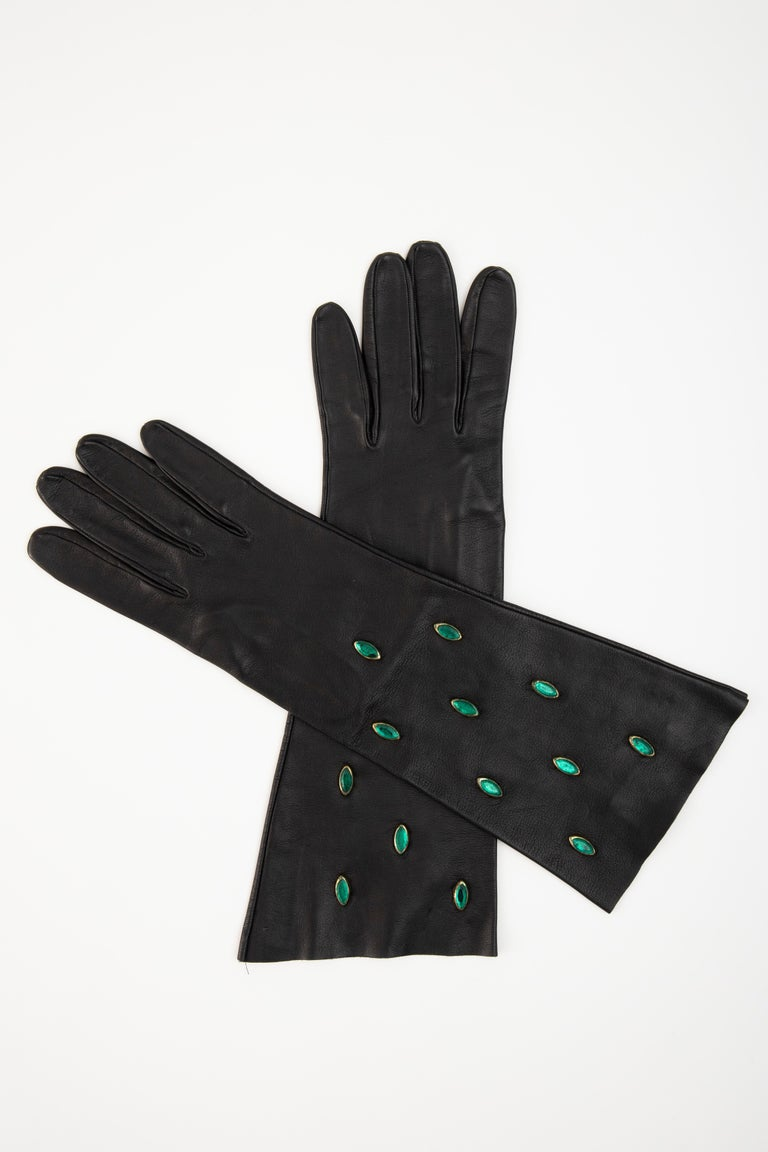 Yves Saint Laurent, Circa:1980's black leather gloves with appliquéd marquise shaped green glass and suede interior.  No Size Label  Fits: 7- 7.5  Length: 14.25