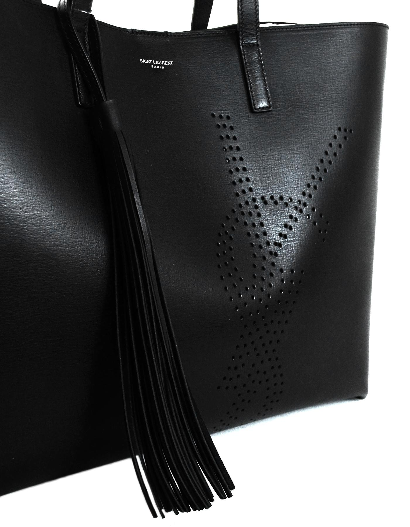 75c54c724eef Yves Saint Laurent Black Leather YSL Perforated Shopping Tote Bag W  Tassel  For Sale at 1stdibs