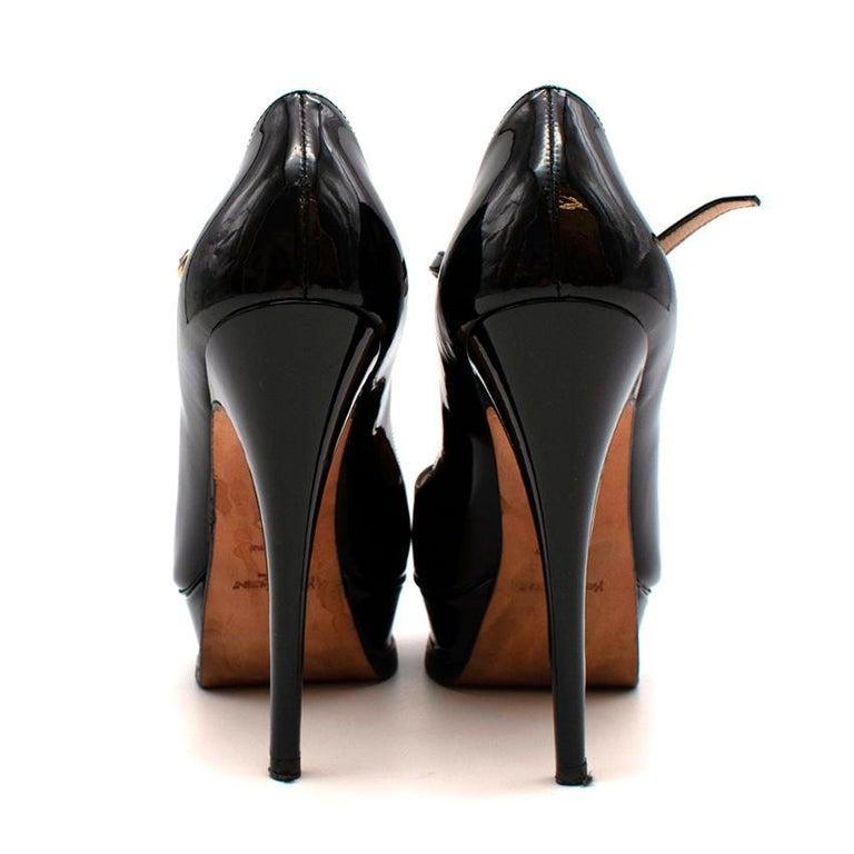 Yves Saint Laurent Black Patent Leather Platform Mary Janes   -Gorgeous patent leather  -Peep toe detail to the front  -Luxurious soft leather lining  -Classic elegant style  -Black hue for easy styling  -Stiletto heels  -Strap with golden buckle
