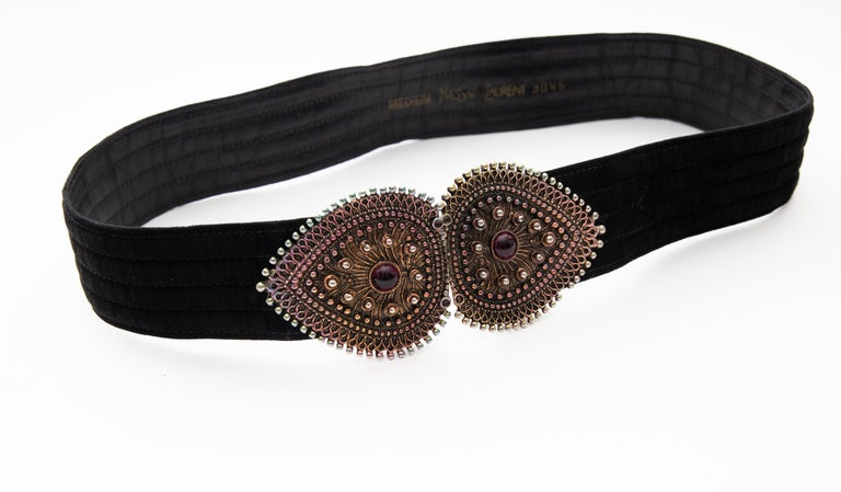 Yves Saint Laurent, late 1980's black velvet, metal, glass cabochons belt with hook closure.  Part of the Met Costume Institute Collection: Accession Number:2006.420.156  Length Max: 34, Width: 3.25