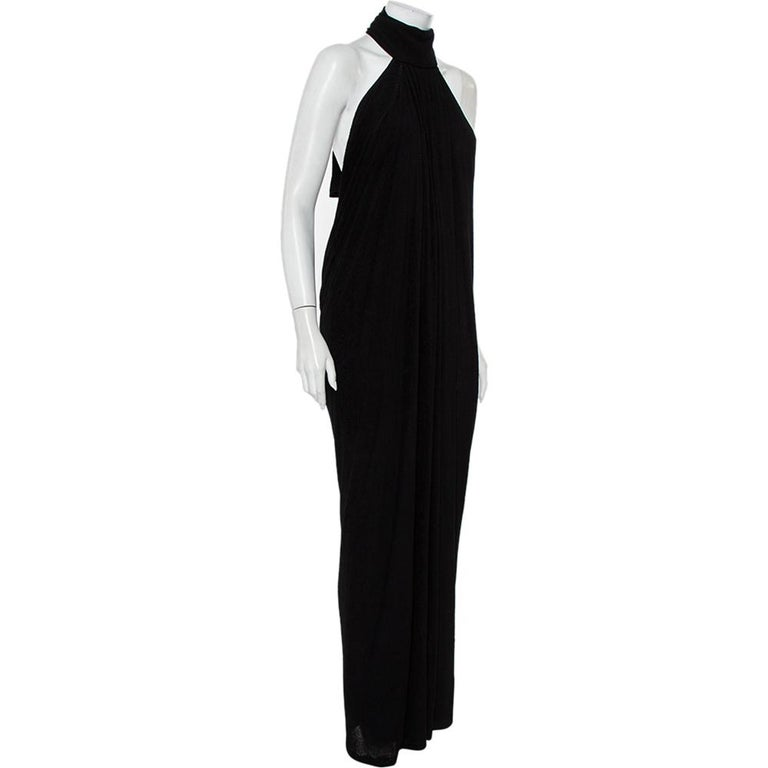 Gorgeous and stunning, this dress by Yves Saint Laurent will assist you with a bold, glamorous look. Crafted with quality fabric blend, it features an impressive halter neck to count on along with an alluring backless design.  Includes: Brand Tag,