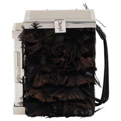 Yves Saint Laurent by Tom Ford feathered case with lighter