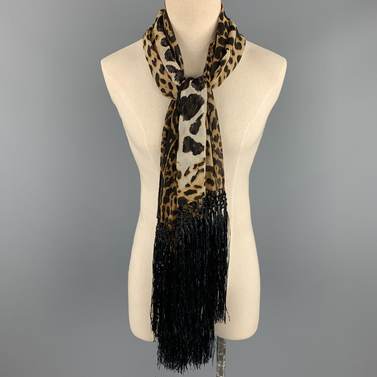 YVES SAINT LAURENT by TOM FORD scarf comes in brown & tan leopard print silk with a twelve inch fringe trim. Made in Italy.   Excellent Pre-Owned Condition:  Measurements:  56 in. x 26 in.