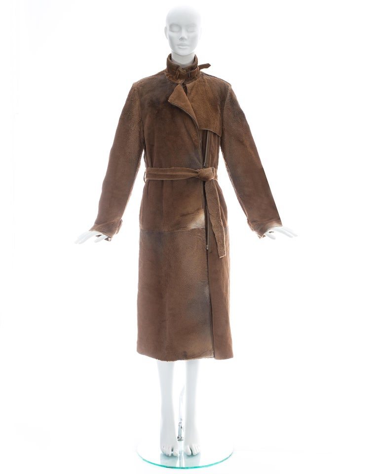 Yves Saint Laurent by Tom Ford; Tan sheared fur coat with two-way open ended zipper, matching fur belt, and two side pockets  Fall-Winter 2002