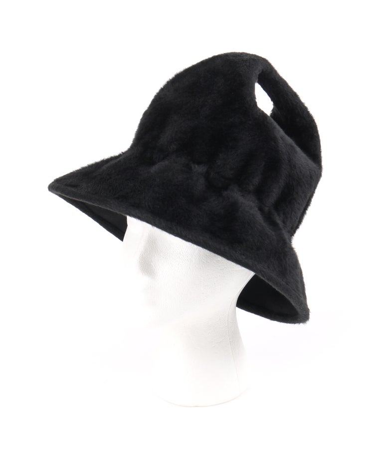 YVES SAINT LAURENT c.1960's YSL Black Felted Angora Fur Top Handle Structured Bucket Hat   Circa: 1960's Label(s): Yves Saint Laurent / Paris - New York / Union Made Style: Bucket Hat Color(s): Black Lined: No  Unmarked Fabric Content: Felted