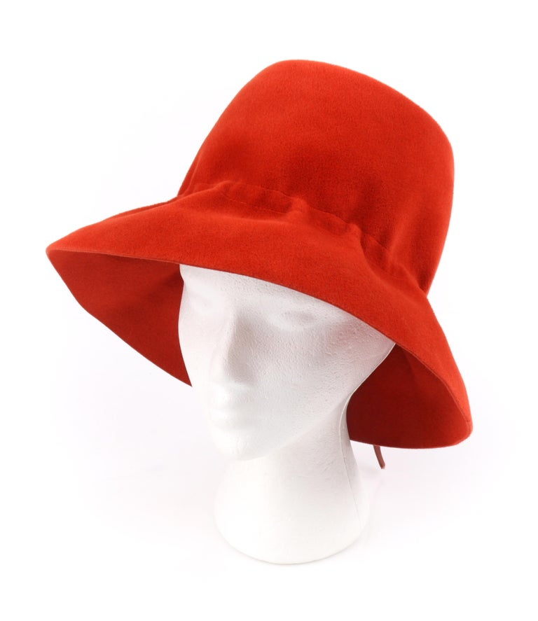 YVES SAINT LAURENT c.1960's YSL Cayenne Red Felted Fur Structured Bucket Hat   Circa: 1960's Label(s): Yves Saint Laurent / Paris - New York / Luxuria Imported Body Made In Italy Style: Bucket Hat Color(s): Red and brown Lined: No  Unmarked Fabric