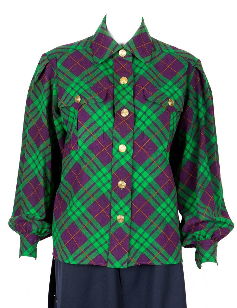 Gorgeous iconic Yves Saint Laurent check woolen stamen shirt jacket featuring a bias green and purple pattern, gold tone fancy front button opening, large bust pockets with gold tone buttons, long sleeves with buttoned cuffs. In excellent vintage