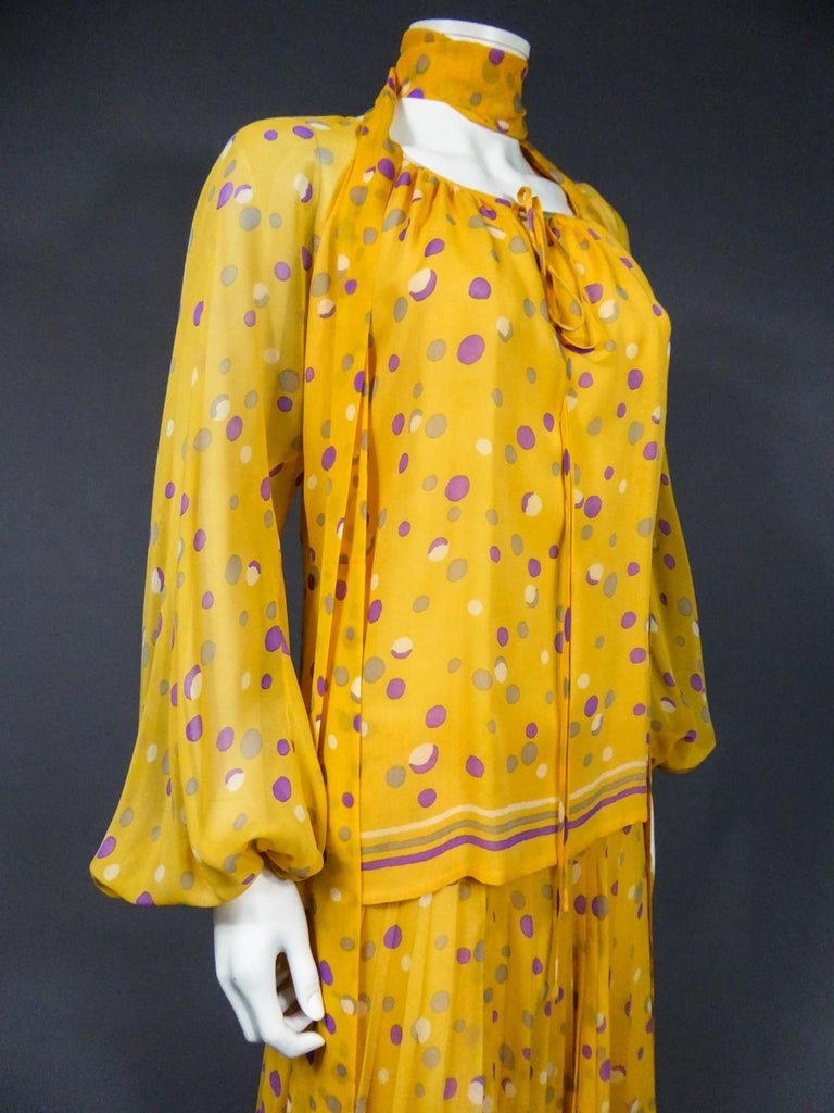 Circa 1970/1975 France  Haute Couture skirt, blouse and scarf set in silk crepe printed with Modern Art patterns of the most prolific period of Yves Saint Laurent in the 1970s. Sunrise yellow printed mousseline with purple, gray and white dots