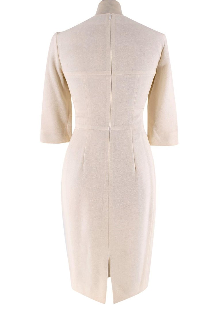 Yves Saint Laurent Cream Fitted Dress  - Textured silk - Knee length skirt - Quarter length sleeves - Round neck fastening - Accentuated waist  Made in France  Fabric Composition: Silk Blend  THERE IS NO SIZE /CARE LABEL, HOWEVER BASED ON THE VIP