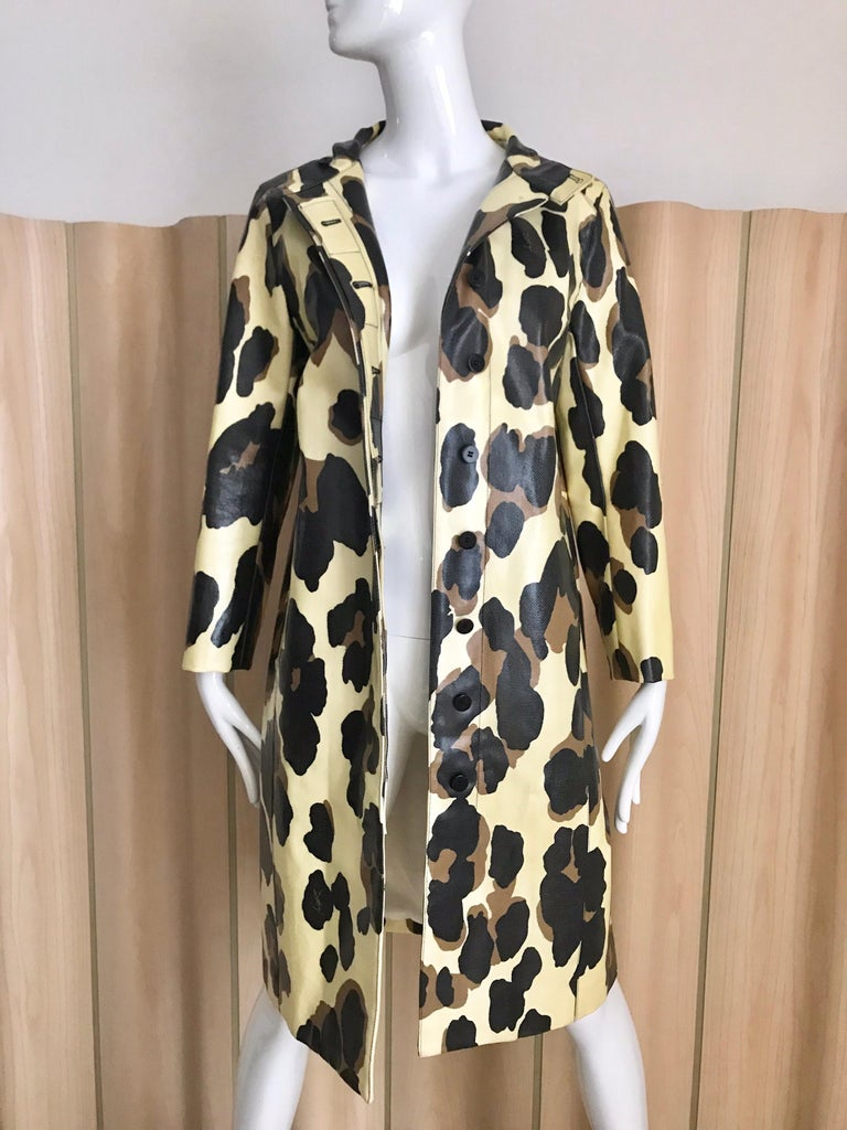 Yves Saint Laurent by Stefano Pilati light Cotton and polyurethane mix  animal print coat in creme and brown leopard print. ( missing belt) coat is lined in silk .  Size: F38 / fit US 4