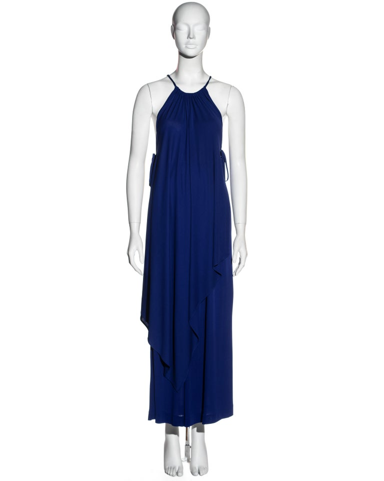 ▪ Yves Saint Laurent Egyptian blue tunic and skirt set ▪ 100% Viscose / Rayon  ▪ Tie fastenings at sides  ▪ Pleated neckline  ▪ Pointed hemline at front and back  ▪ Matching high-waisted maxi skirt  ▪ FR 36 - UK 8 - US 4 ▪ c. 1970s