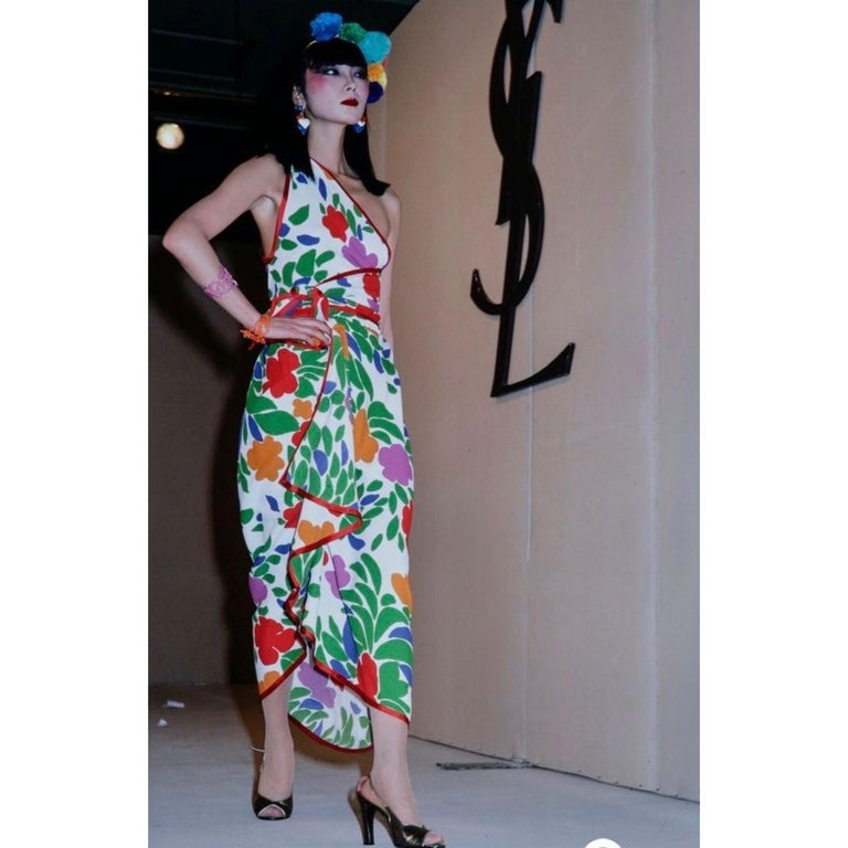 The late 1970s marked a playful design style for YSL. While several of his couture collections drew inspiration from famed artists, bolder and more casual prints also began to make their debut. From 1979, this sarong-style ensemble is made from a