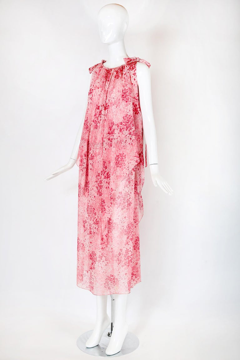 Vintage Yves Saint Laurent pink floral printed chiffon double-layered sleeveless tunic-style dress with an elastic waistband at the interior tunic dress, a gathered elastic neckline, a slit up the left side and extra long fabric ties at each