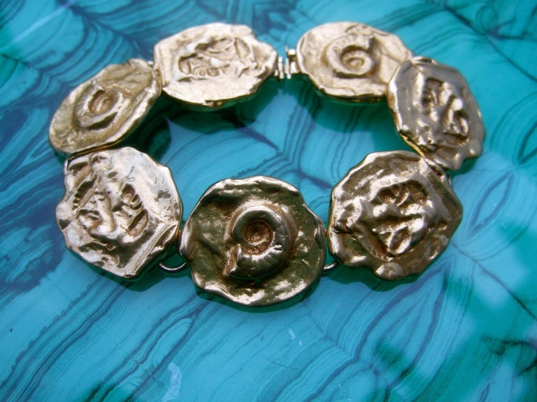 Yves Saint Laurent Gilt Metal Circular Medallion Link Bracelet c 1980s In Good Condition For Sale In Santa Barbara, CA