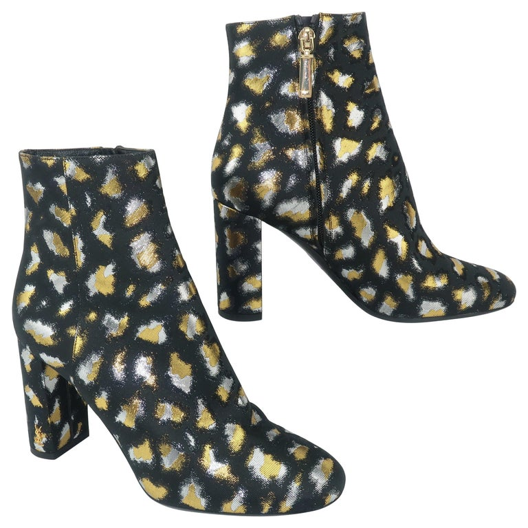 Yves Saint Laurent leopard-print boots, offered by Modern & Moore